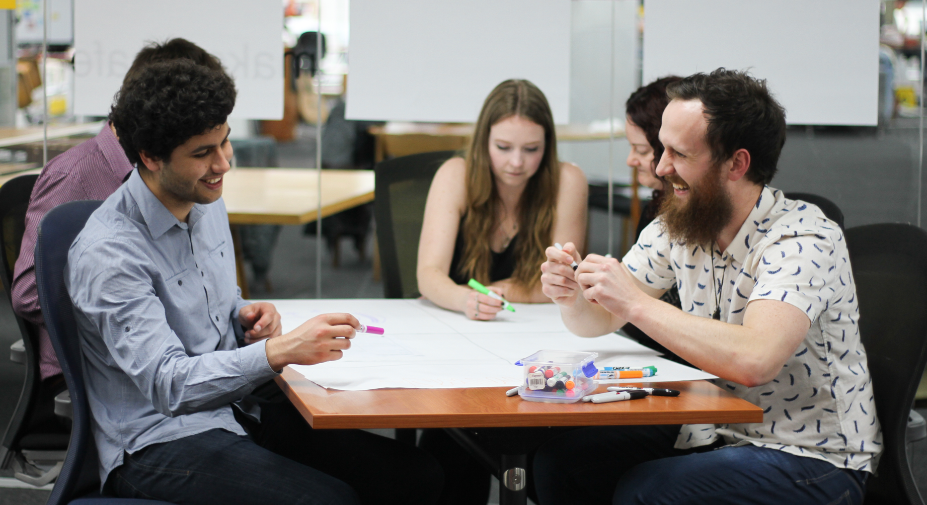 Team collaborating on an activity at a free project discovery workshop.