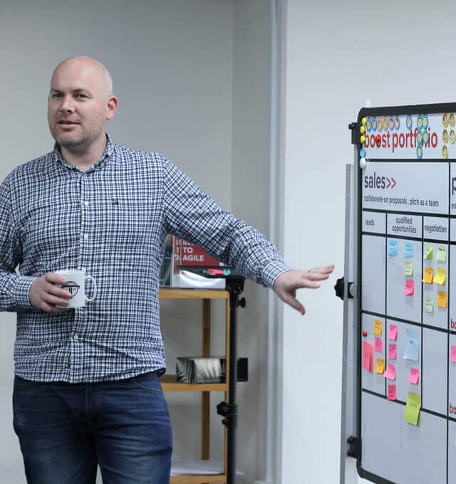 A Boost Agile coach discussing options for a discovery workshop agenda at the company's portfolio board.